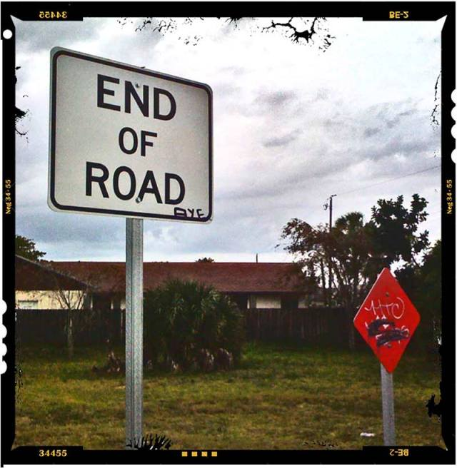 A street sign that reads, End of Road