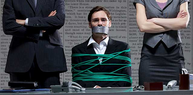 Illustration of man tied up in in front of a desk with tape over his mouth.